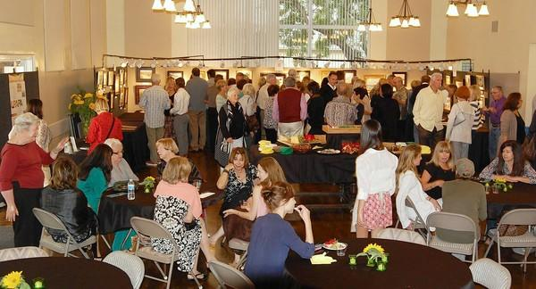 "The crowd at the Laguna Plein Air Painters Assn.'s ""Canvas for a Cause"" fundraiser, held earlier this month."