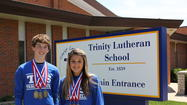 Tinley Park's Trinity Lutheran eighth graders Joel Seielstad and Autumn Wabi earn medals at LSA State Track & Field Meet