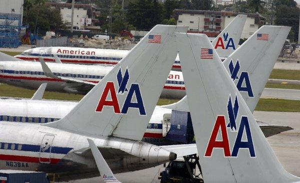 American Airlines changed its boarding policy Thursday to give additional consideration to passengers with carry-on items that don't require an overhead bin.