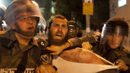 JERUSALEM -- Thousands of young ultra-Orthodox men protested Thursday night against a government proposal to, for the first time, draft them into the military.