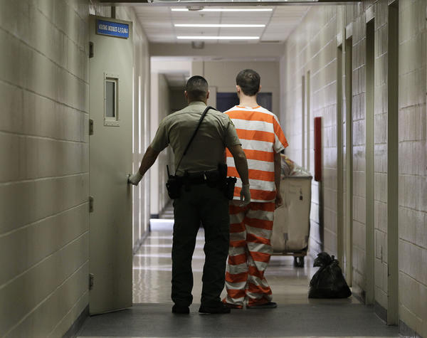 An inmate at the Madera County Jail is taken to one of the inmate housing units.