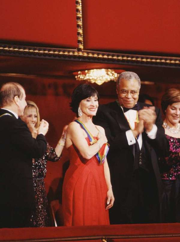 Chita Rivera receives an ovation at the 2002 Kennedy Center Honors ceremony, with fellow winner James Earl Jones applauding and First Lady Laura Bush at far right. Rivera and Placido Domingo, in 2000, are the only Latino winners, out of more than 170 honorees since 1978.