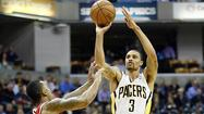 Indiana Pacers George Hill shoots the basketball over Atlanta Hawks Jeff Teague during their NBA first round playoff game in Indianapolis