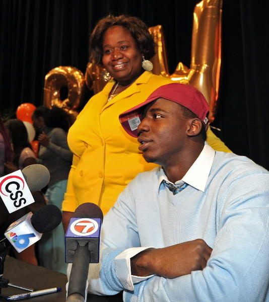 Booker T. Washington offense linebacker Matthew Thomas stands next to his mother Mariska Nyon and announces that he will attend Florida State on National Signing Day at Booker T. Washington.