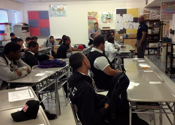 Michael Vaught, a security officer at Hartford Public High School, talks to Law and Government Academy students Thursday about what it takes to be a man with integrity.