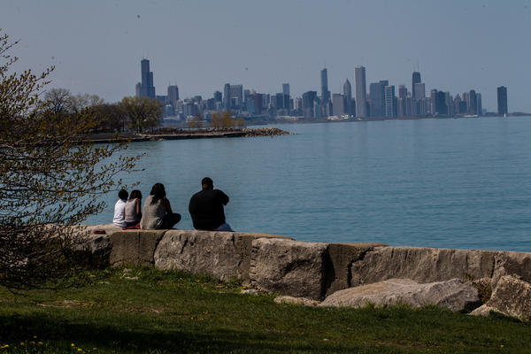 A family enjoys Chicago skyline from the Promontory Point in Hyde Park on Wednesday, May 8, 2013.