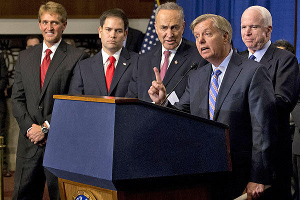 Sen. Lindsey Graham (R-S.C.), second from right, speaks about immigration reform during a news conference in Washington. A bipartisan group of House lawmakers has reached agreement on an immigration bill that would parallel work underway in the Senate with Graham and his colleagues.