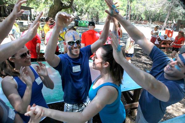 Blue team members celebrate a win in Color Wars at Camp JCA Shalom in Malibu.