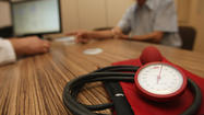NEW YORK (Reuters Health) - Being under stress at work is tied to a higher risk of heart problems, new research confirms - but putting down the beer bottle and going for a walk may help.
