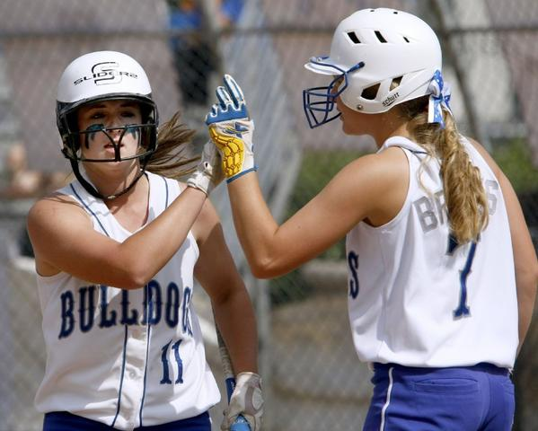 Burbank High's Katie Hooper blasted a three-home home run over the left-field fence in the bottom of the sixth inning. Sophomore pitcher Caitlyn Brooks shut it down in the seventh inning with her 13th, 14th and 15th strikeouts, giving the Bulldogs a 7-2 victory at McCambridge Park.