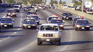 Freeway chase in the white Bronco