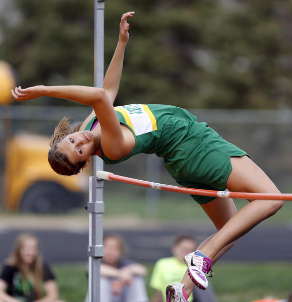 Northwestern's Jordan Peterson goes over the bar in the girls high jump event Thursday at the Region 1B track meet in Groton. photo by john davis taken 5/16/2013