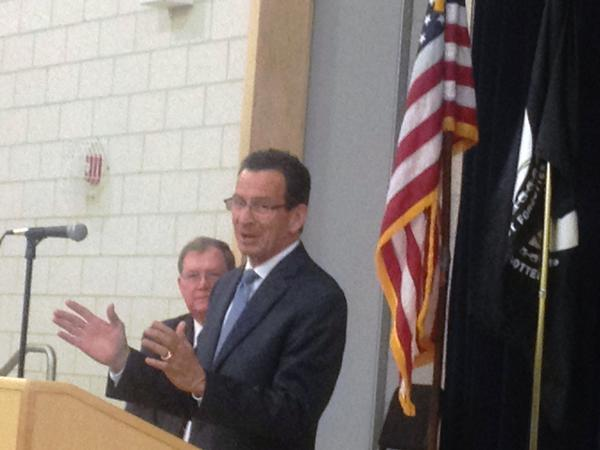 Gov. Dannel P. Malloy speaks Thursday evening at a community forum in Bristol as Mayor Art Ward listens on.