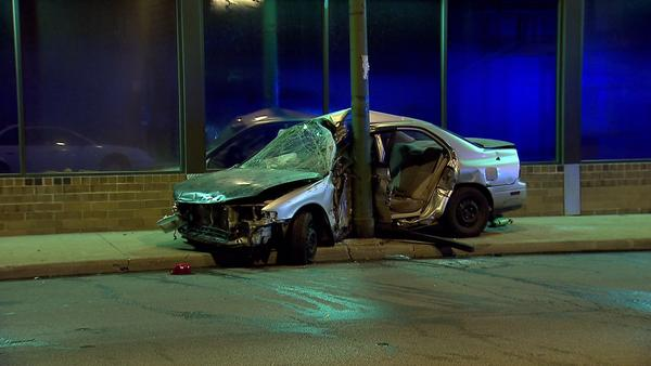 Four people were injured when their car hit a pole in the Avondale neighborhood.