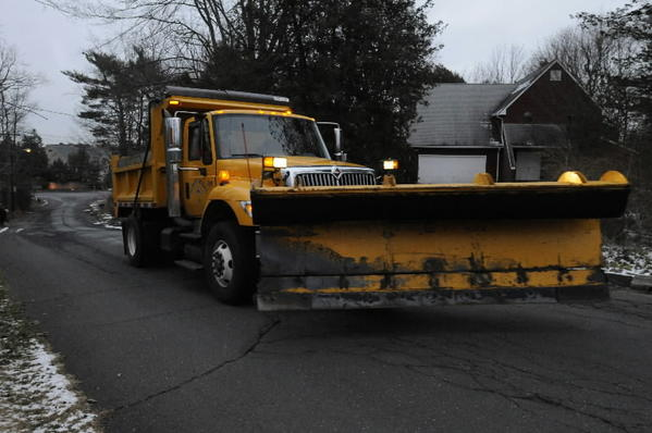 Brian LaFort of West Hartford Public Works puts down ice melt on the secondary roads before the storm hit in December.