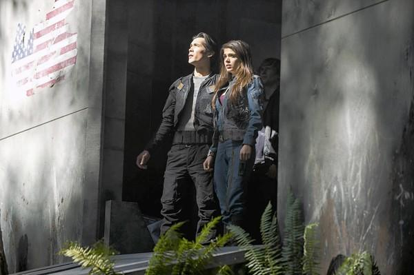 "Bob Morley and Marie Avgeropoulos in ""The 100."""