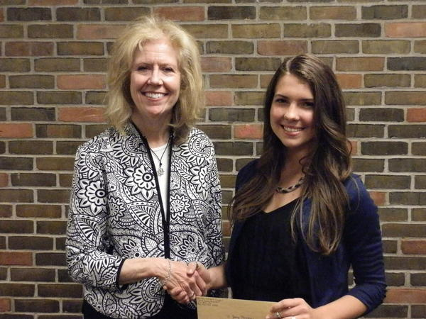 Sally Smith of Petoskey (left), representing the Bay View Woman's Council, presents a $1,000 check to Petoskey High School senior Zoey Reager, daughter of Nicole Belmonte and Wyndham Reager of Petoskey. The scholarship award is given to a Petoskey High School senior girl who demonstrates and shows an appreciation for volunteerism in her school and community. Zoey will attend New York University Stern School of Business in the fall of 2013.