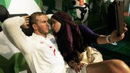 Woman poses with wax figure of David Beckham at Madame Tussauds Wax Museum in Bangkok