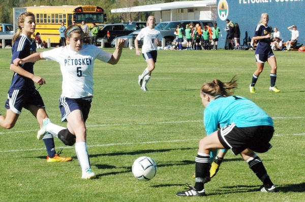 Petoskey senior Liz Fraser (5) races in on goal during Thursday's Big North Conference match against Gaylord at the Click Road Soccer Complex. The Northmen defeated the Blue Devils, 1-0.