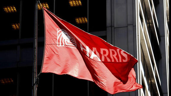 A flag flies outside of the then Harris Savings Bank & Trust in a 2008 file photo.