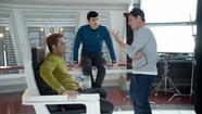 "Chris Pine, left, Zachary Quinto and director J.J. Abrams on the set of ""Star Trek Into Darkness."" (Zade Rosenthal/ Paramount)"