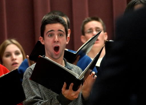 In this file photo from Dec. 13, 2001, Manchester High School senior Anthony DeDominicis sings along with other members of the Manchester High School Roundtable Singers during a Christmas party.