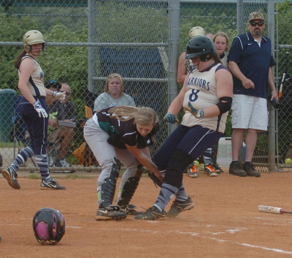 Makayla Browning of Danville Christian scores ahead of a tag by North Hardin Christian catcher Janey Gray during the fourth inning of DCA's 9-6 victory in its final regular-season game Thursday.
