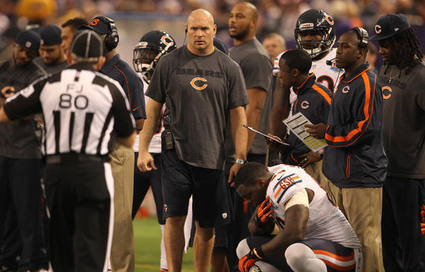 Former Chicago Bears middle linebacker Brian Urlacher (center) turns 35 on may 25.