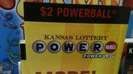 Winning numbers to the drawing are: 10, 13, 14, 22, 52, Powerball 11. Officials estimate the jackpot at $590.5 million.