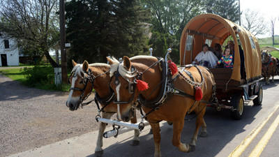 Wagon train travels through Addison