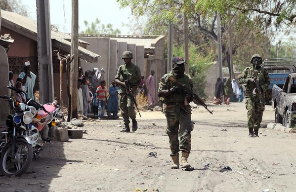 Nigerian troops patrol the streets of the remote northeast town of Baga in Borno state.
