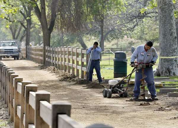 Construction workers install fence posts on a new horse and walkers trail that begins at the Glendale Narrows Riverwalk in Glendale and goes along Bette Davis Park in L.A. in March.