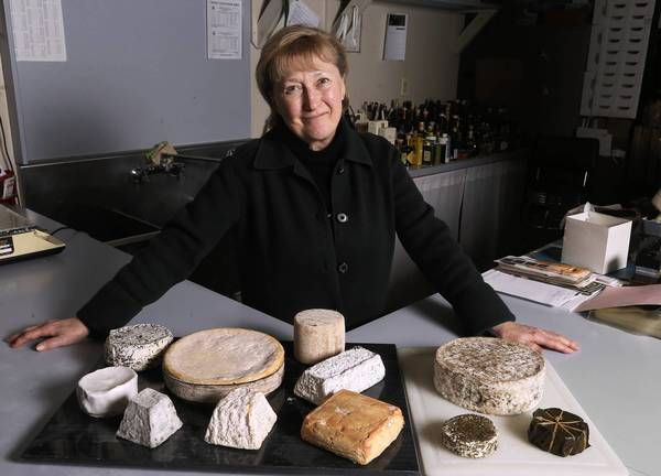Sofia Solomon with some of the fine cheeses that she imports, shown at the warehouse of her company, Tekla Inc., in Chicago.
