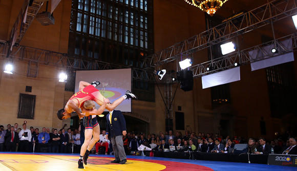 Kyle Dake of the USA takes down Hassan Tahmasebi of Iran during the Rumble on the Rails Wrestling at Grand Central Terminal in New York City.  (Elsa / Getty Images)