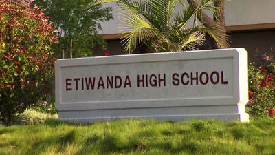 A 16-year-old Etiwanda High School student was arrested on suspicion of distributing nude photos of four teenage girls through Twitter.