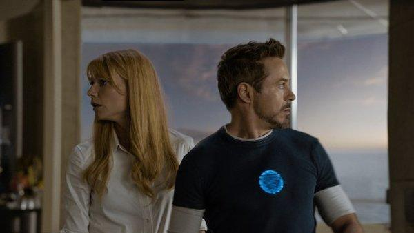 "Gwyneth Paltrow and Robert Downey Jr. star in ""Iron Man 3,"" which crossed the $1 billion milestone at the worldwide box office on Thursday."