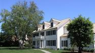 North Shore Builders' latest colonial style home, 986 Grove in Winnetka, embodies the company's mission of building historically inspired, energy efficient and luxury homes on the North Shore. Nestled perfectly on a 1/2 acre wooded home site in Hubbard Woods, this gorgeous home priced at $2,389,000 boasts 5,386 square feet of luxurious living space, with a 2,115 square foot finished basement. The winding driveway, three car garage and all brick exterior add a charming and polished look to this custom home that is perfect for family living.