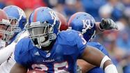 The Kansas City Chiefs have signed former Kansas defensive end Toben Opurum as an undrafted free agent after trying him out as a fullback during rookie minicamp.