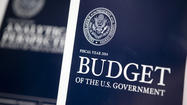 Obama budget would cut deficits, report says