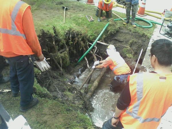 Glendale Water & Power crews work to repair a water main break on Friday.