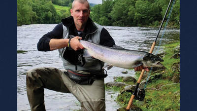 Michael Mauri with an Atlantic Salmon caught and released on the Orkla River in Norway.