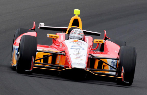 E.J. Viso drives through the first turn during practice for the Indianapolis 500 race.