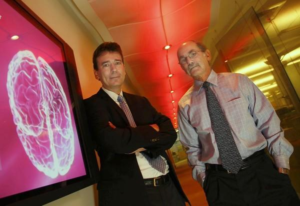 Paul Thompson, left, and Arthur Toga, experts in brain imaging research, are leaving UCLA to join the faculty at USC. They'll bring with them millions of dollars in annual research funding — not to mention considerable prestige for the Bruins' crosstown rival.