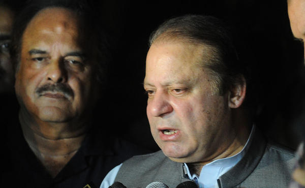Pakistan's newly elected Prime Minister Nawaz Sharif speaks to the media as he leaves the hospital where Pakistani politician Imran Khan was admitted after being injured, in Lahore.