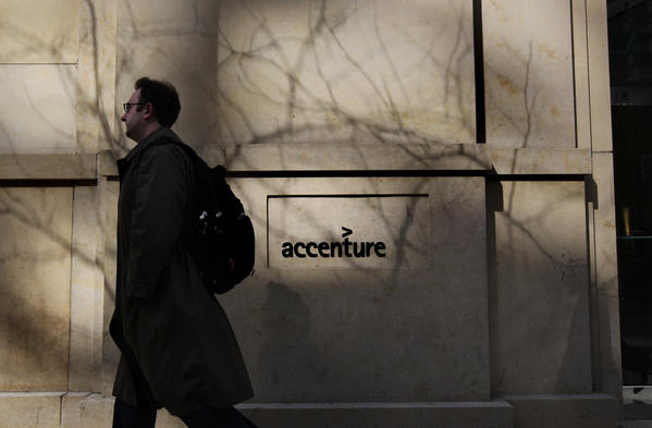A man walks past a building at 180 N. LaSalle in Chicago, partially occupied by the company Accenture, on Wednesday, April 13, 2011.