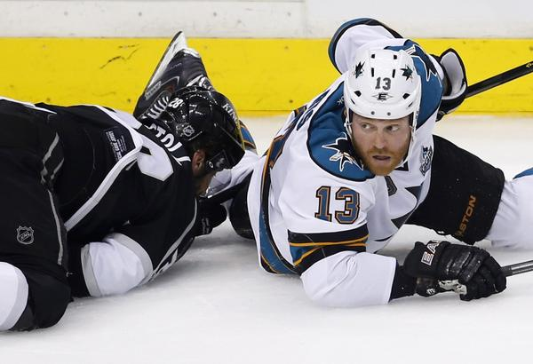 The Sharks' Raffi Torres looks up after hitting the Kings' Jarret Stoll to the ice in Game 1.