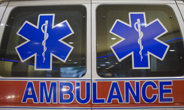 Medical symbols are pictured on the rear windows of an ambulance parked outside New York Presbyterian Hospital June 11, 2009.