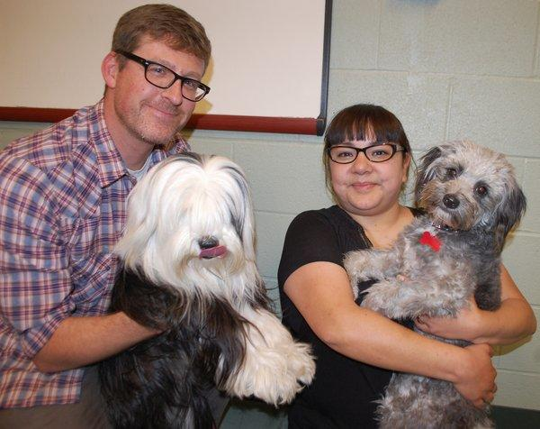 A 10-month-old puppy named Banjo, right, was tied to train tracks in Riverside County last month. He was adopted Friday by Jeff and Louisa Moore of Huntington Beach, who also own 2-year-old Lali.
