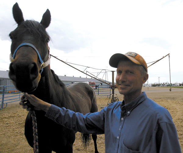 Tom Moody, standing with the horse Owhataknight, has been involved with the pari-mutuel horse races in Aberdeen for more than 30 years.