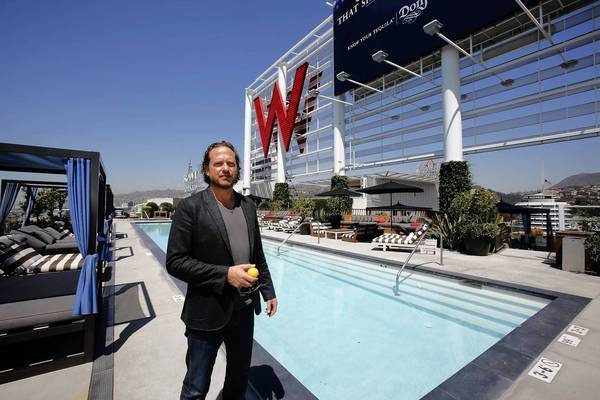 Ron Barnes, director of sales and marketing for the Residences at the W Hollywood, shows off the rooftop all-season pool, which is open 24 hours a day. Penthouses at the W Hollywood are priced from $1 million to $45 million.